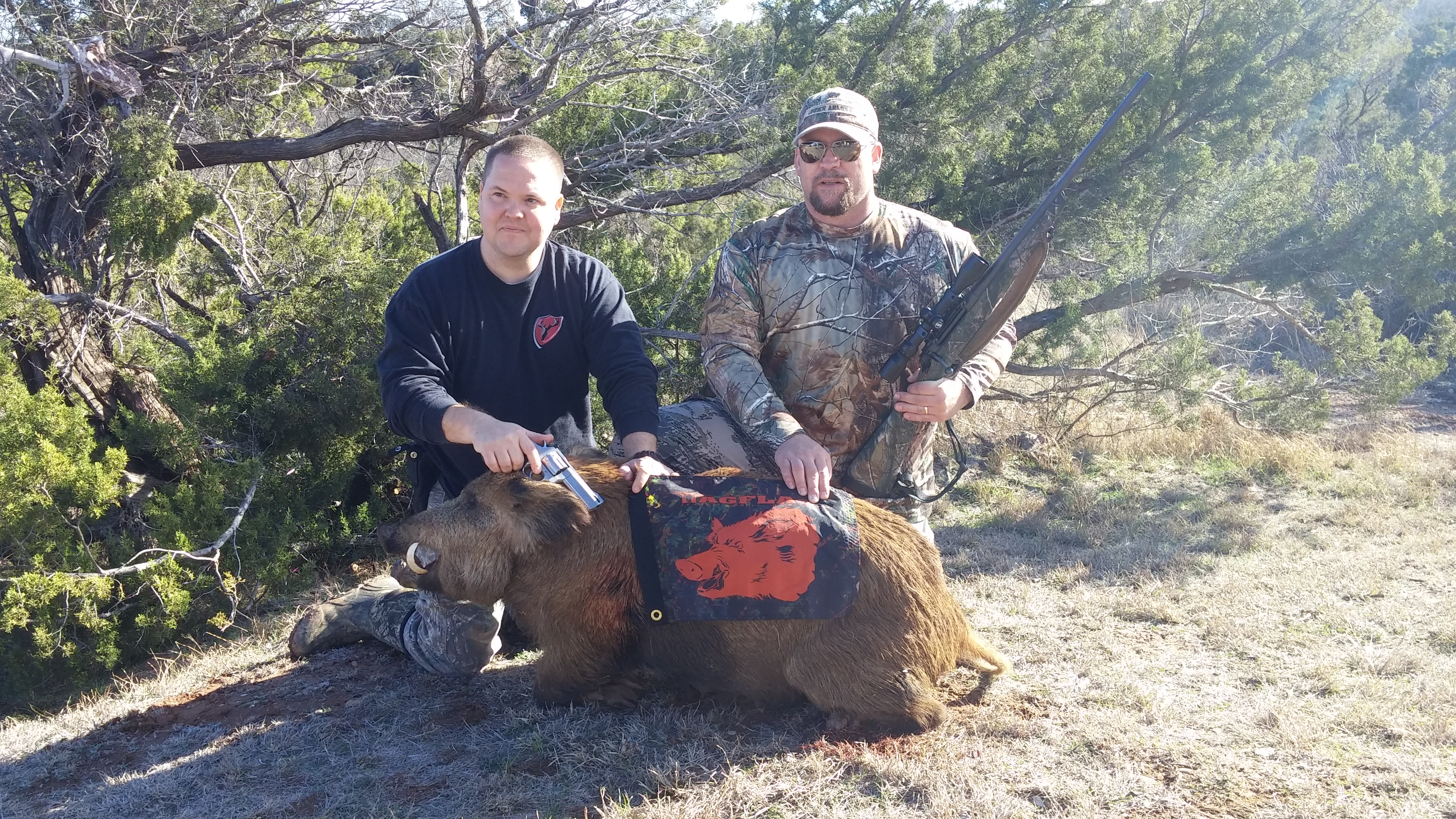Trav and Nate with the toughest pig in Texas.