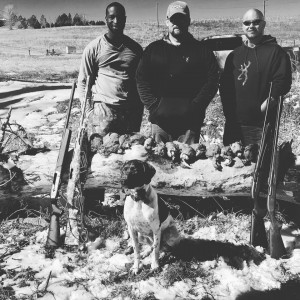 Jerimee, Travis, Greg, and Remi after a snowy hunt.